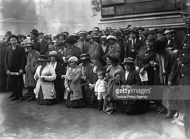 Crowds reciting a rosary outside the gates at Downing Street London during treaty negotiations between representatives of Sinn Fein and the British...