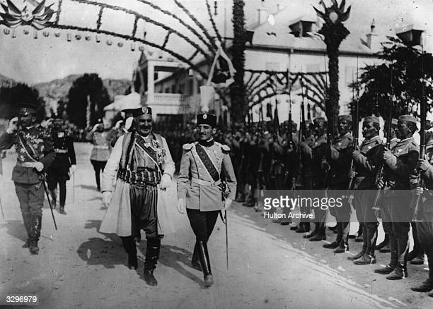 Nicholas King of Montenegro inspecting troops with the Crown Prince of Serbia at Cetinje