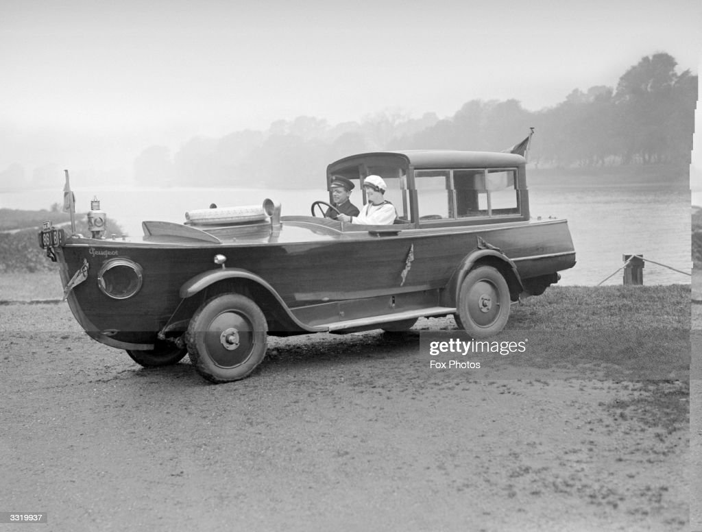 The Peugeot motorboat car on a river bank The front end is shaped like the bow of a boat the middle part like a car and it has wheels