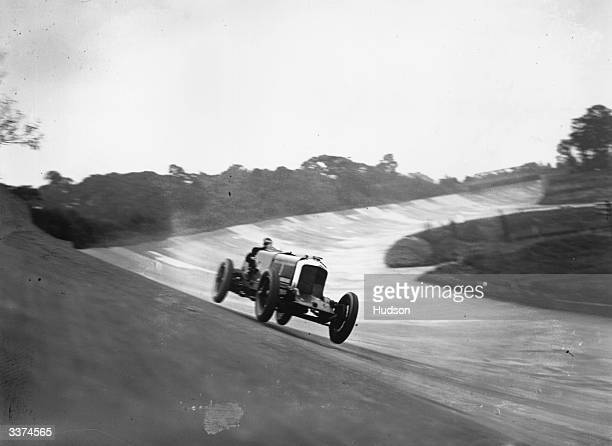 Cyril Paul in a Bentley taking a bank at 120 mph in a 500 mile motor race at Brooklands