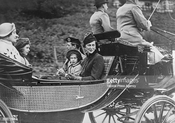 George Duke of Kent with Marina Duchess of Kent travelling in a carriage with Princess Margaret Rose Princess Elizabeth and Queen Elizabeth Queen...