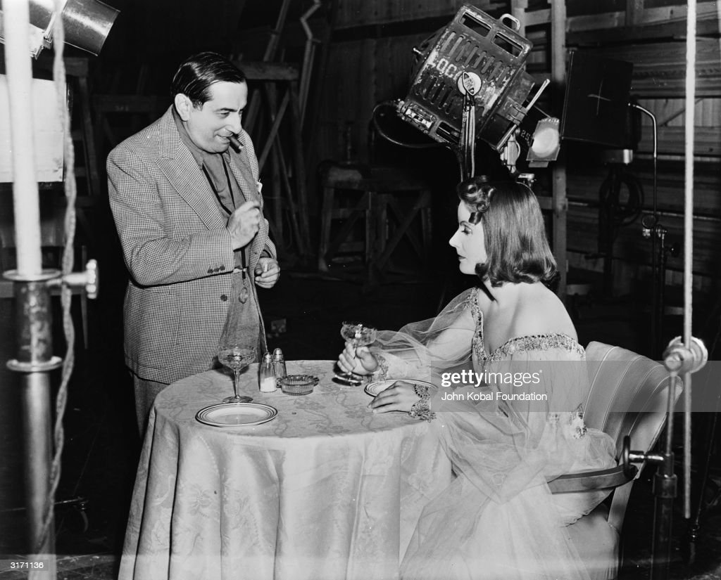 Swedish-American actress Greta Garbo (1905 - 1990) on set with film director Ernst Lubitsch (1892 - 1947) during the filming of the romantic drama 'Ninotchka'.