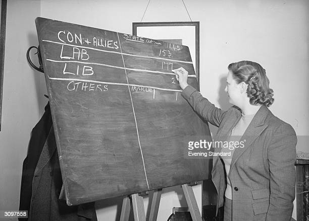 Betty Caselton chalks up results as the votes are counted during the General Election