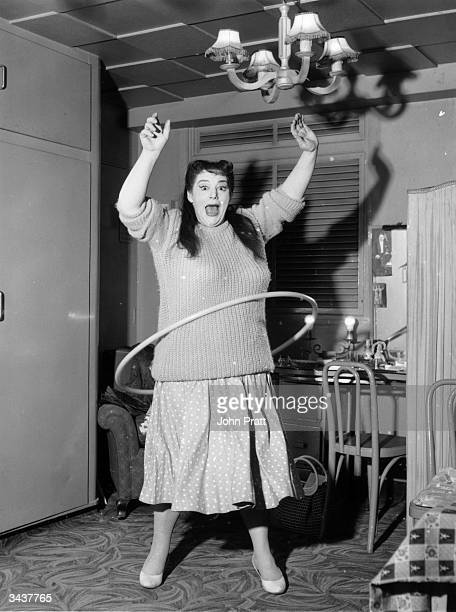 English actress Hattie Jacques practising the hulahoop