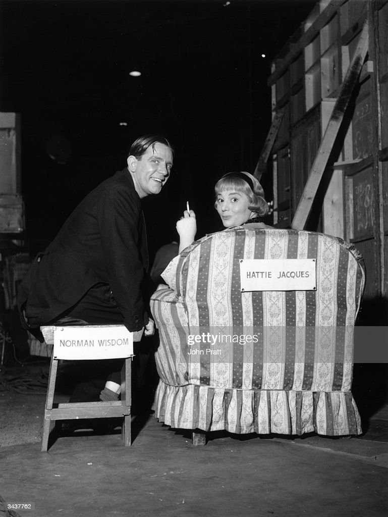 English actress Hattie Jacques (1924 - 1980) with Norman Wisdom relaxing between takes while filming 'Follow A Star'.