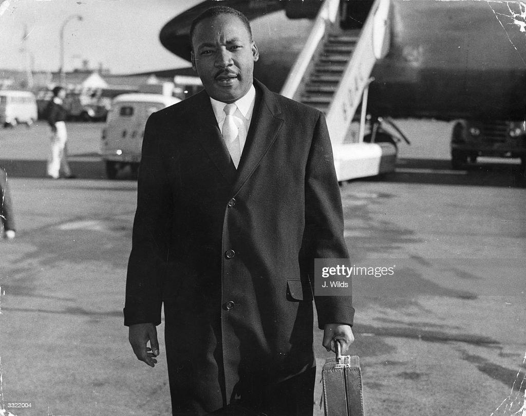 American civil rights campaigner <a gi-track='captionPersonalityLinkClicked' href=/galleries/search?phrase=Martin+Luther+King&family=editorial&specificpeople=70030 ng-click='$event.stopPropagation()'>Martin Luther King</a> (1929 - 1968) arriving at London Airport. He is in England to be the chief speaker at a public meeting about colour prejudice and to appear on the BBC television programme 'Face To Face'.