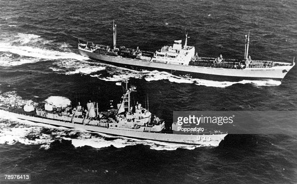 October 1962 The Cuban Missile Crisis American Navy ship USS Barry steams alongside the Soviet Freighter Anosov which was believed to be carrying a...