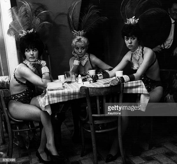 Three showgirls in the Windmill Theatre canteen after hearing that the theatre is to close down The artistes are from left to right Pat Patterson...