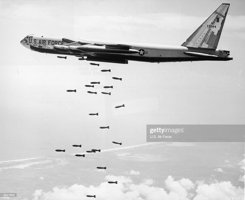 Air Force strategic air command (SAC) B-52 stratofortress drops a string of 750-pound bombs over a coastal target in the Republic of Vietnam during the Vietnam War. Official U.S. Air Force photo released by the Department of Defense.