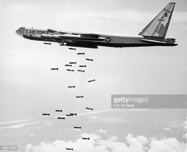A US Air Force strategic air command B52 stratofortress drops a string of 750pound bombs over a coastal target in the Republic of Vietnam during the...