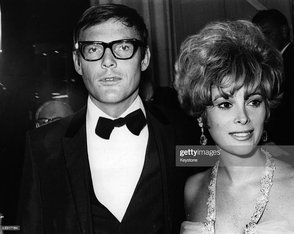 American actor Adam West with the actress Jill St John at the premiere of director John Huston's film, 'The Bible'.