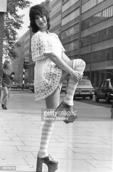 Model Sue Coddington wearing typical 1970's fashion shows off the eight inch heels on her platform shoes