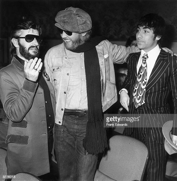 British drummer Ringo Starr formerly of The Beatles gestures in conversation with American singer Harry Nilsson and English drummer Keith Moon of The...