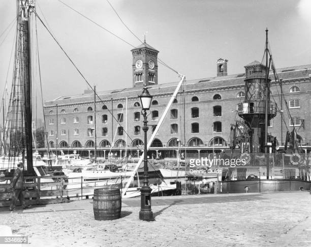 St Katherine's Dock in London with old Tea House in the background and lightship 'Nore' on the right