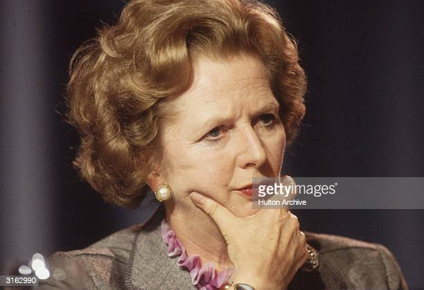 British prime minister Margaret Thatcher looking pensive at the Conservative Party Conference in Blackpool