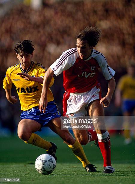 27 October 1990 Football League Division One Arsenal v Sunderland Arsenal striker Paul Merson is pursued by the yellow shirted Paul Bracewell