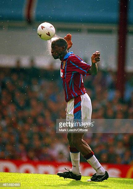 22 October 1994 Premiership Football Aston Villa v Nottingham Forest Water sprays off the head of Villa defender Ugo Ehiogu as heads the ball