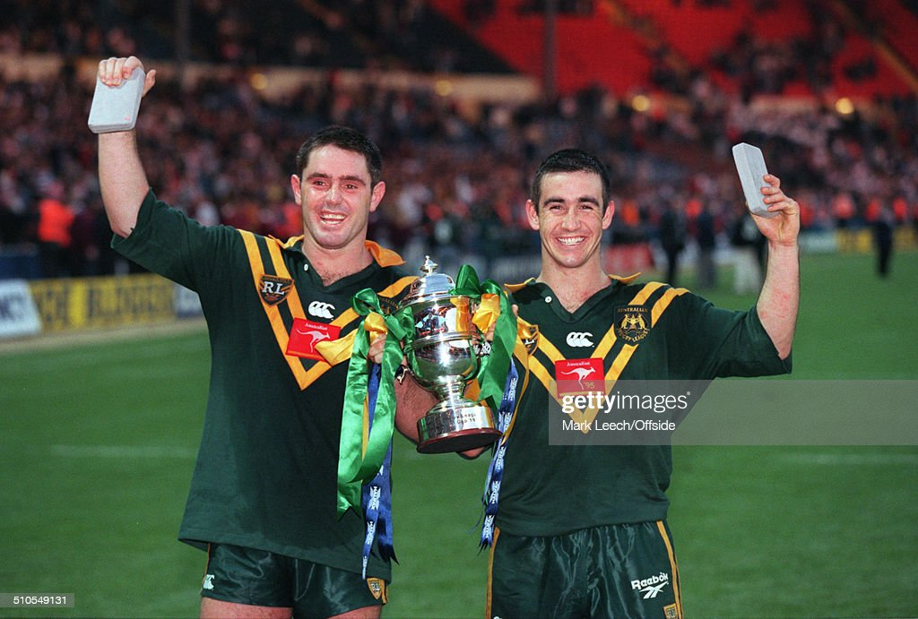 28 October 1995 Rugby League World Cup Captain Brad Fittler and Andrew Johns of Australia hold the trophy