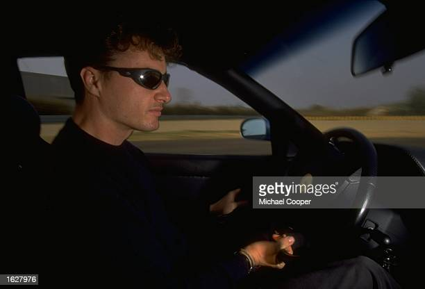 Eddie Irvine of Great Britain behind the wheel of a Ferrari 355 at the test track in Fiorana Italy Mandatory Credit Mike Cooper /Allsport