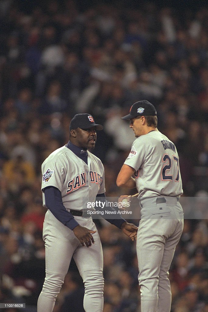 Pitching coach Dave Stewart of the San Diego Padres talks to Kevin Brown during the Padres 96 loss to the New York Yankees in game two of the World...