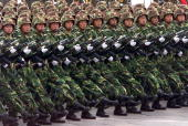October 1999 file photo shows Chinese People's Liberation Army soldiers marching with their bayonettes during a military parade commemorating the...