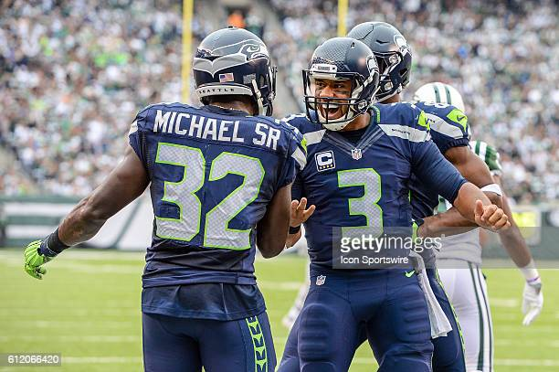 Seattle Seahawks Quarterback Russell Wilson and Seattle Seahawks Running Back Christine Michael celebrate a touchdown during the New York Jets versus...
