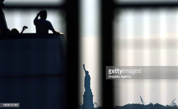 The Statue of Liberty is seen from the Staten Island Ferry on 2 October 2013 in New York City Tourists who go to New York City to visit Statue of...