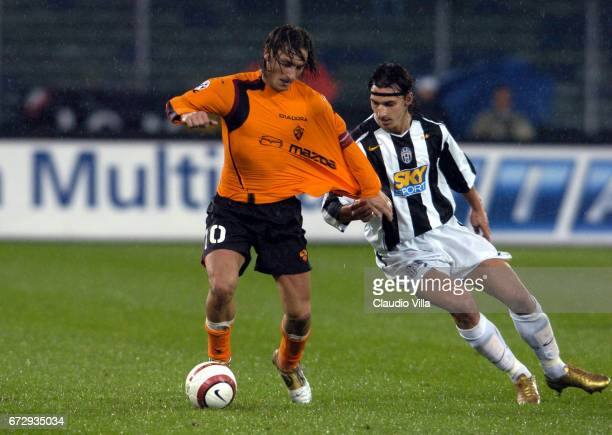 Zlatan Ibrahimovic of Juventus FC and Francesco Totto of AS Roma compete for the ball during the italian Serie A 2004/2005 8 th round macht played...