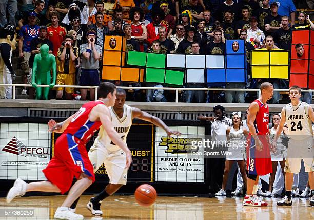 Members of the Paint Crew student section including a row dressed as the video game Tetris cheer on Purdue during the Boilermakers 9462 win over the...