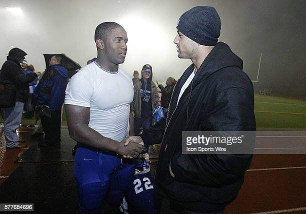 Former All West sound running back Ryan Cole congratulated Larry Dixon of Olympic High school after he broke his rushing record of 4654 yards Dixon...
