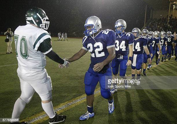 Olympic High school running back Larry Dixon congratulates the Port Angeles Rough Riders after the game Dixon broke the West Sound rushing record of...