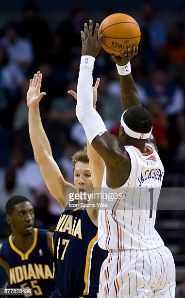 Charlotte Bobcats shooting guard Stephen Jackson works to shoot over Indiana Pacers small forward Mike Dunleavy during an NBA basketball game at Time...