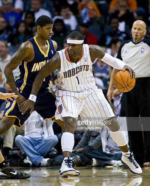 Charlotte Bobcats shooting guard Stephen Jackson works to drive against Indiana Pacers point guard Darren Collison during an NBA basketball game at...