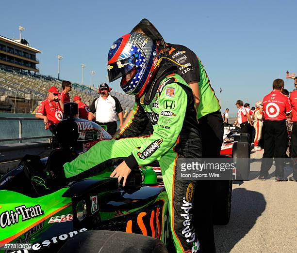 Danica Patrick gets in her car on pit row during the qualifying for the Cafes do Brasil Indy 300 IZOD INDYCAR series race at the HomesteadMiami...