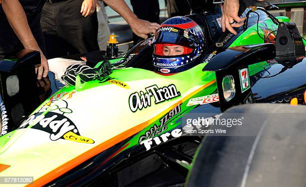 Danica Patrick sits in her car on pit row during the qualifying for the Cafes do Brasil Indy 300 IZOD INDYCAR series race at the HomesteadMiami...