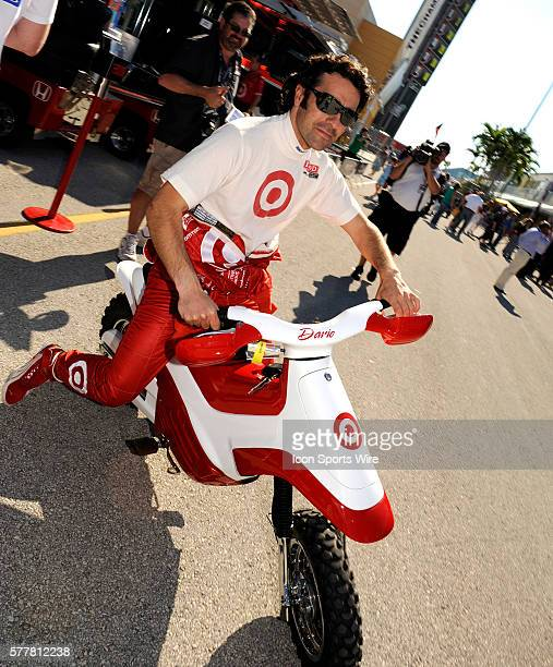 Dario Franchittie rides on a scooter in the garage during the qualifying for the Cafes do Brasil Indy 300 IZOD INDYCAR series race at the...