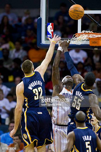 Indiana Pacers power forward Josh McRoberts and center Roy Hibbert work for a rebound against Charlotte Bobcats shooting guard Stephen Jackson during...
