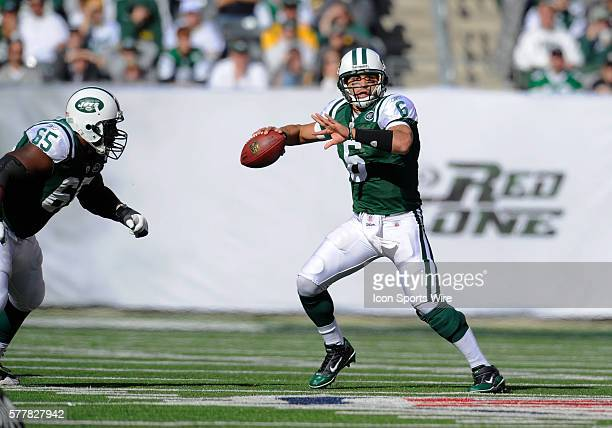 New York Jets quarterback Mark Sanchez runs in the pocket looking to pass during the first half of the Green Bay Packets vs New York Jets game at the...