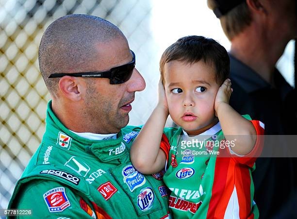 Tony Kanaan smiles as his threeyearold son Leonardo covers his ears on pit row during the qualifying for the Cafes do Brasil Indy 300 IZOD INDYCAR...