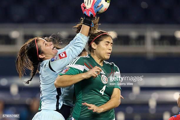 Dinnia Diaz grabs the ball off of the head of Alina Garciamendez The Mexico Women's National Team played the Costa Rica Women's National Team at...