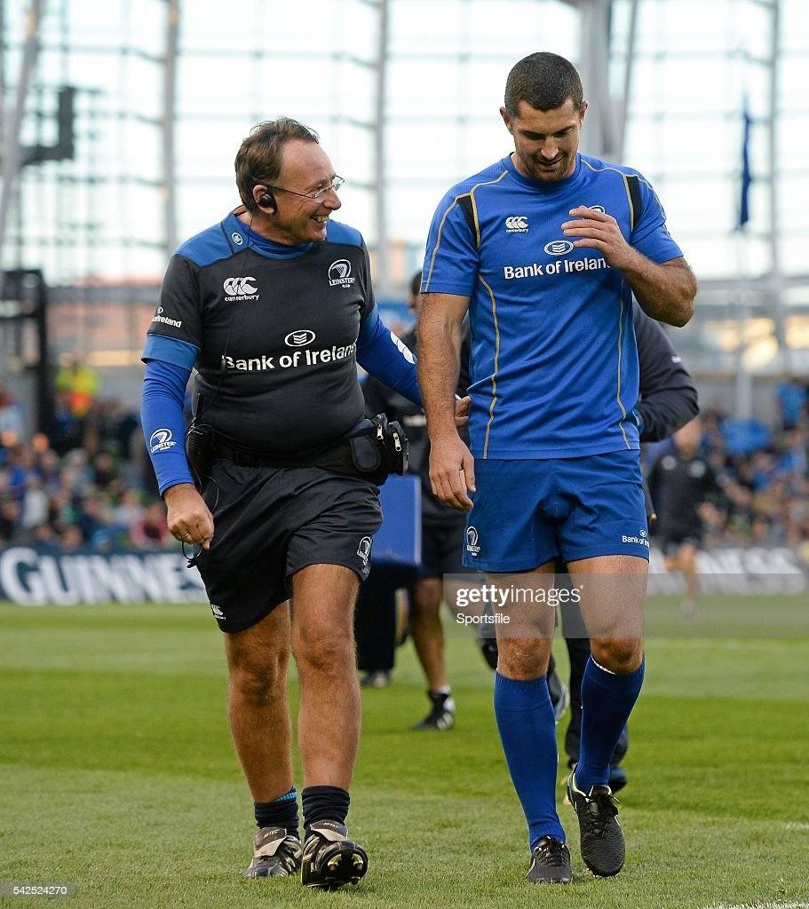 4 October 2014 Leinster team doctor Professor John Ryan walks off the field with Rob Kearney who was initially named in the starting 15 but dropped...