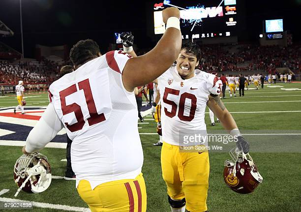 USC Trojans guard Damien Mama celebrates with guard Toa Lobendahn after the end of the Pac12 college football game against the Arizona Wildcats at...