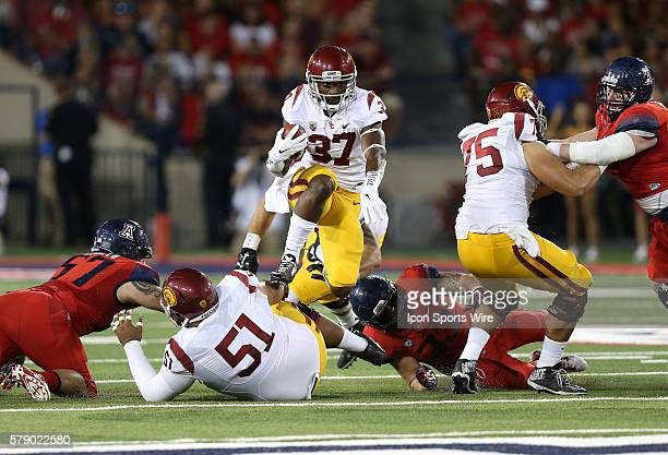 USC Trojans running back Javorius Allen leaps over guard Damien Mama during the second quarter of the Pac12 college football game against the Arizona...