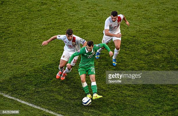 11 October 2014 Wes Hoolahan Republic of Ireland in action against Liam Walker left and Lee Casciaro Gibraltar UEFA EURO 2016 Championship Qualifer...
