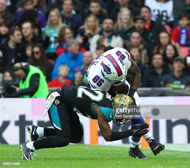 Aaron Colvin tackles Charles Clay during the International Series Game 13 between the Buffalo Bills and the Jacksonville Jaguars played at Wembley...