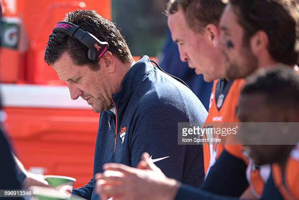 Denver Broncos Quarterbacks/Passing Game Coordinator Greg Knapp reviews plays on a Microsoft Surface Pro 3 tablet with Denver Broncos Quarterback...