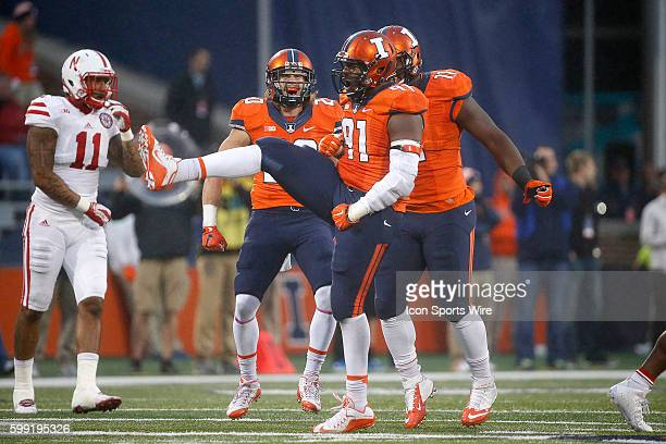 Illinois Fighting Illini defensive end Dawuane Smoot celebrates after tackling Nebraska Cornhuskers quarterback Tommy Armstrong Jr in action during a...