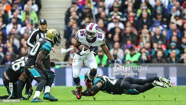 LeSean McCoy is tackled by Aaron Colvin during the International Series Game 13 between the Buffalo Bills and the Jacksonville Jaguars played at...
