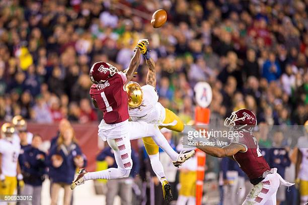 Notre Dame Fighting Irish wide receiver Will Fuller grabs the hand of Temple Owls defensive back Tavon Young while they are in the air trying to...