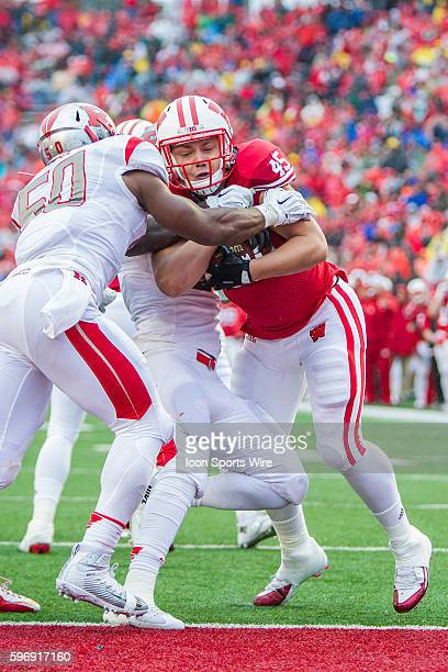 Wisconsin Badgers running back Alec Ingold gets stopped at the 1 yard line by Rutgers Scarlet Knights linebacker Quentin Gause as the Wisconsin...